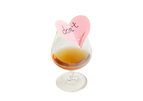 glass of alcohol with a note in the shape of a heart and the words don't